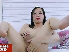 Ladyboy strips off stockings before tugging