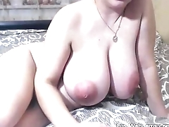 Pregnant babe with huge tits toys herself on cam