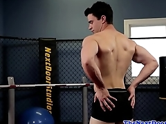 Muscular workout hunk tugging his cock solo